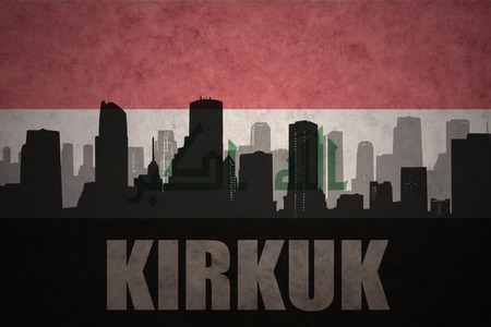 iraqi: abstract silhouette of the city with text Kirkuk at the vintage iraqi flag background