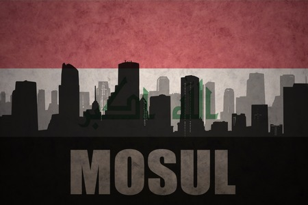 iraqi: abstract silhouette of the city with text Mosul at the vintage iraqi flag background Stock Photo