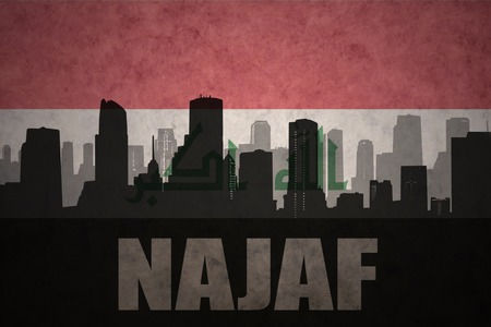 iraqi: abstract silhouette of the city with text Najaf at the vintage iraqi flag background