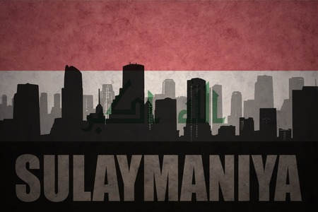 iraqi: abstract silhouette of the city with text Sulaymaniya at the vintage iraqi flag background