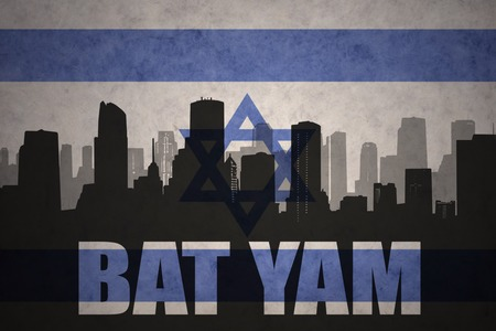 yam israel: abstract silhouette of the city with text Bat Yam at the vintage israel flag background Stock Photo