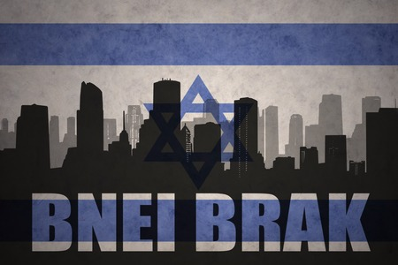 brak: abstract silhouette of the city with text Bnei Brak at the vintage israel flag background