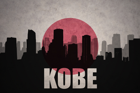 clash: abstract silhouette of the city with text Kobe at the vintage japanese flag background