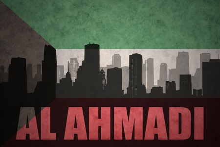 middle east conflict: abstract silhouette of the city with text Al Ahmadi at the vintage kuwait flag background