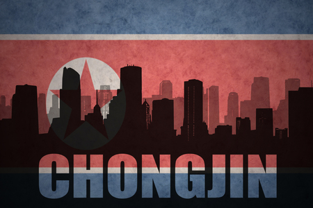 clash: abstract silhouette of the city with text Chongjin at the vintage north korea flag background Stock Photo