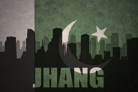 middle east conflict: abstract silhouette of the city with text Jhang at the vintage pakistan flag background