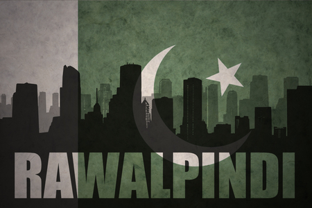 middle east conflict: abstract silhouette of the city with text Rawalpindi at the vintage pakistan flag background