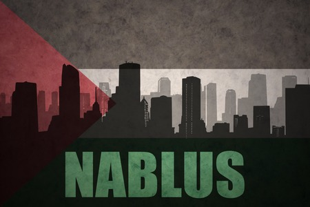 nablus: abstract silhouette of the city with text Nablus at the vintage palestinian flag background