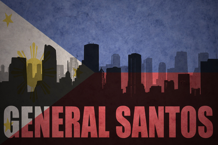 general: abstract silhouette of the city with text General Santos at the vintage philippines flag background