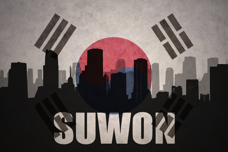 clash: abstract silhouette of the city with text Suwon at the vintage south korea flag background