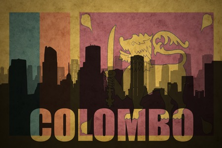 colombo: abstract silhouette of the city with text Colombo at the vintage sri lanka flag background