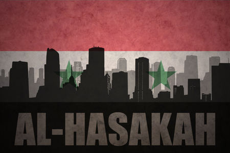 middle east conflict: abstract silhouette of the city with text Al-Hasakah at the vintage syrian flag background
