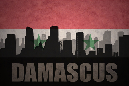 middle east conflict: abstract silhouette of the city with text Damascus at the vintage syrian flag background