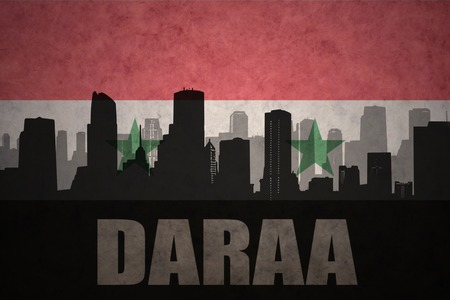 syrian: abstract silhouette of the city with text Daraa at the vintage syrian flag background