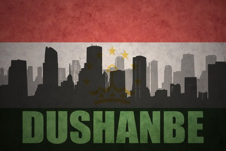 tajikistan: abstract silhouette of the city with text Dushanbe at the vintage tajikistan flag background