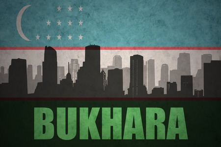 clash: abstract silhouette of the city with text Bukhara at the vintage uzbekistan flag background