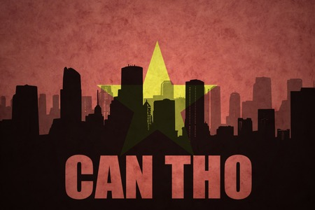 can tho: abstract silhouette of the city with text Can Tho at the vintage vietnamese flag background