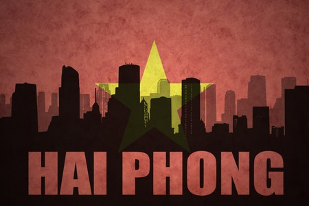 clash: abstract silhouette of the city with text Hai Phong at the vintage vietnamese flag background Stock Photo