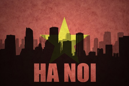 ha: abstract silhouette of the city with text Ha Noi at the vintage vietnamese flag background