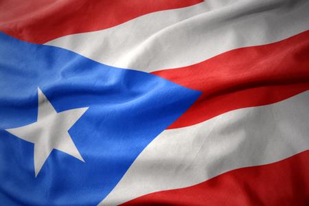 bandera de puerto rico: waving colorful national flag of puerto rico. Foto de archivo