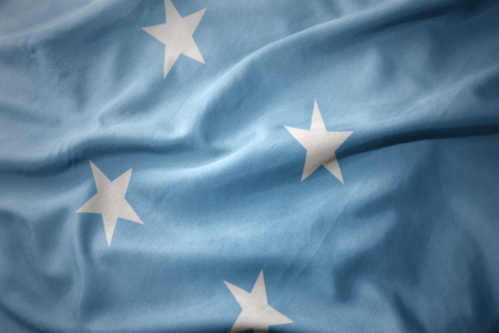 micro print: waving colorful national flag of Federated States of Micronesia. Stock Photo