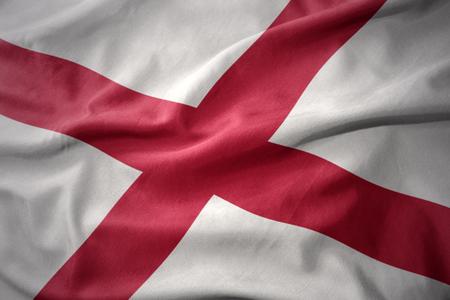 alabama state: waving colorful national flag of alabama state.