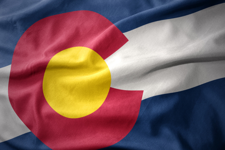 waving colorful national flag of colorado state. Stock Photo