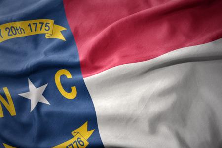 north carolina: waving colorful national flag of north carolina state. Stock Photo