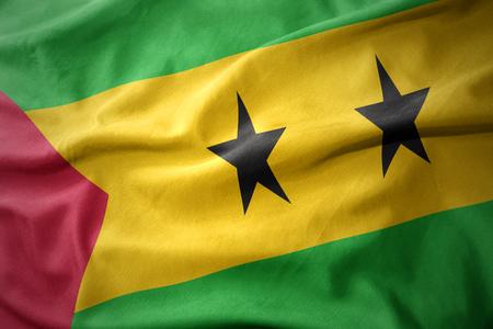 waving colorful national flag of sao tome and principe. Stock Photo