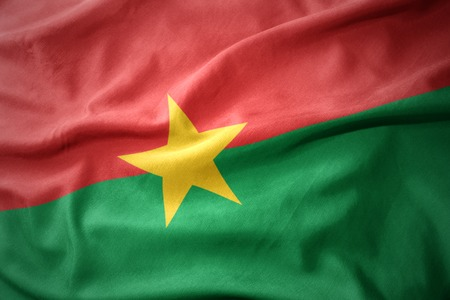 waving colorful national flag of burkina faso.