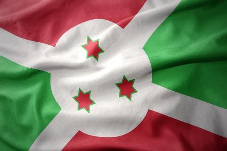waving colorful national flag of burundi. Stock Photo