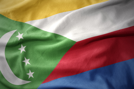 waving colorful national flag of comoros.