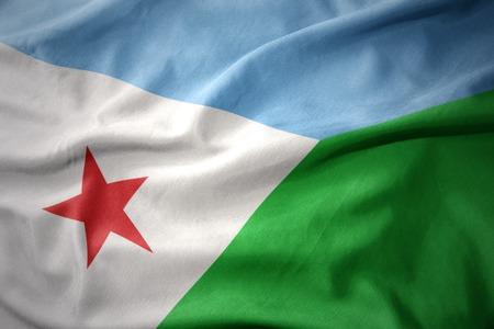 waving colorful national flag of djibouti. Stock Photo