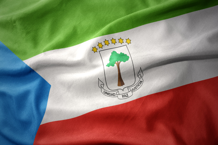 equatorial: waving colorful national flag of equatorial guinea.
