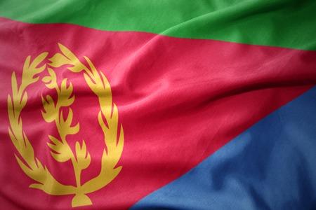 waving colorful national flag of eritrea. Stock Photo