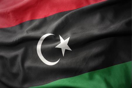 waving colorful national flag of libya. Stock Photo