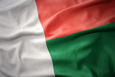 waving colorful national flag of madagascar.
