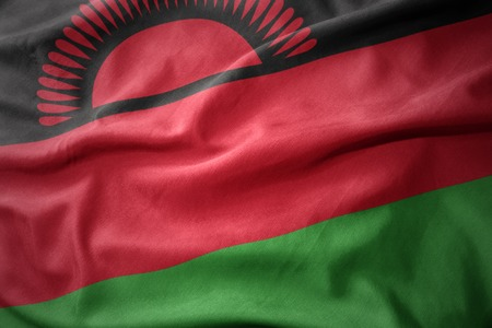 waving colorful national flag of malawi. Stock Photo