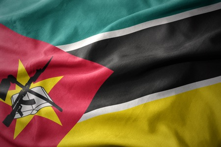 waving colorful national flag of mozambique.