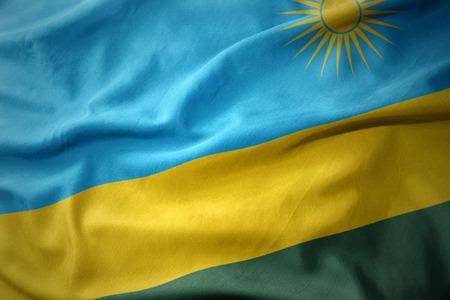 waving colorful national flag of rwanda. Stock Photo