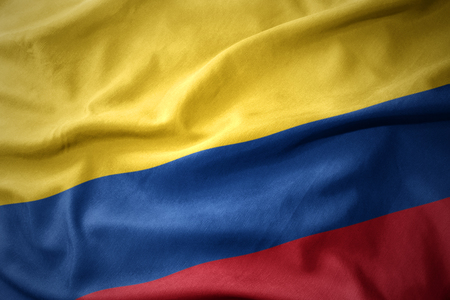 micro print: waving colorful national flag of colombia. Stock Photo