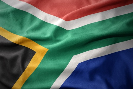 micro print: waving colorful national flag of south africa.