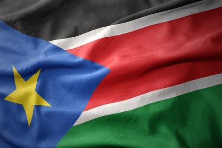 south sudan: waving colorful national flag of south sudan.
