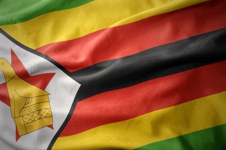 zimbabwe: waving colorful national flag of zimbabwe. Stock Photo