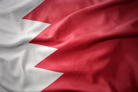 waving colorful national flag of bahrain.