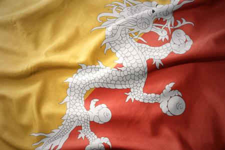 bhutan: waving colorful national flag of bhutan.