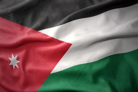 waving colorful national flag of jordan.