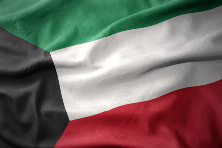 micro print: waving colorful national flag of kuwait. Stock Photo