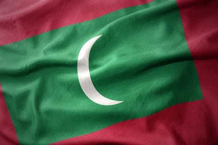 waving colorful national flag of maldives.