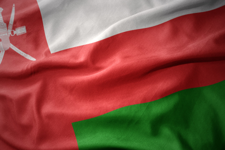 waving colorful national flag of oman. Stock Photo